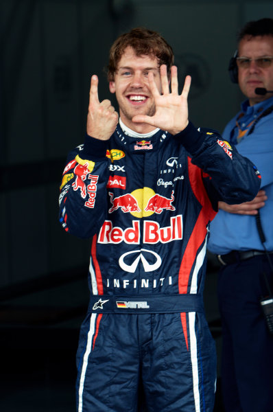 Interlagos, Sao Paulo, Brazil. 26th November 2011. Pole man Sebastian Vettel, Red Bull Racing RB7 Renault, celebrates. Portrait.  World Copyright: Steve Etherington/LAT Photographic ref: Digital Image SNE27566