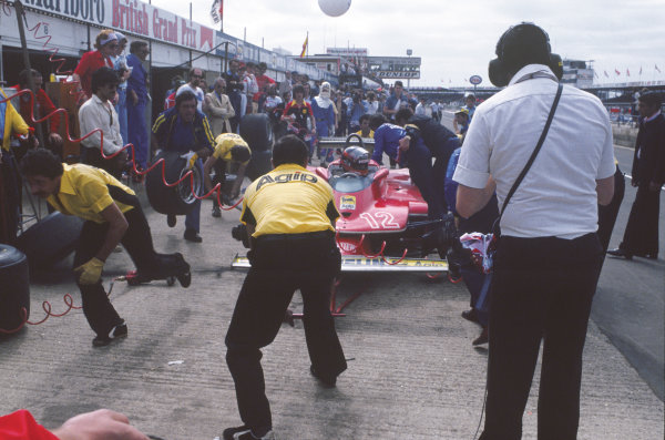 Silverstone, England. 12th - 14th July 1979.Gilles Villeneuve (Ferrari 312T4) 14th position, pit stop, action. World Copyright - LAT Photographic.Ref: 79GB24