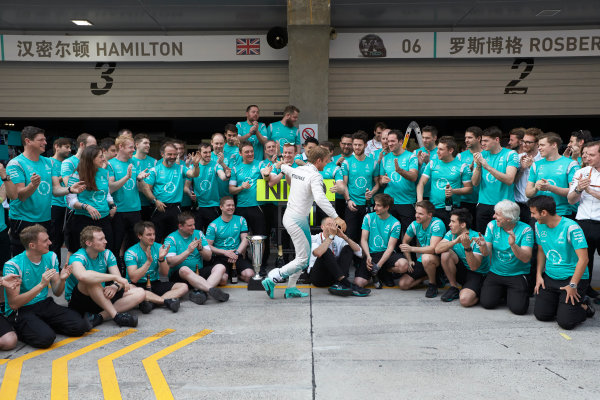 Shanghai International Circuit, Shanghai, China. Sunday 17 April 2016. Nico Rosberg, Mercedes AMG, 1st Position, Tony Ross, Race Engineer, Mercedes AMG, and the Mercedes team celebrate victory after the race. World Copyright: Steve Etherington/LAT Photographic ref: Digital Image SNE21987