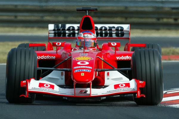 2003 Hungarian Grand Prix - Friday Qaulifying, Budapest, Hungary.22nd August 2003.Rubens Barrichello, Ferrari F2003 GA, action.World Copyright LAT Photographic.Digital Image Only.