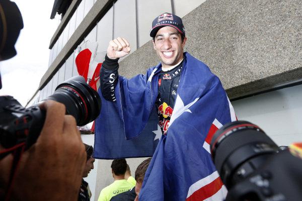 Circuit Gilles Villeneuve, Montreal, Canada. Sunday 8 June 2014. Daniel Ricciardo, Red Bull Racing, 1st Position, celebrates with his team. World Copyright: Alastair Staley/LAT Photographic. ref: Digital Image _79P1329