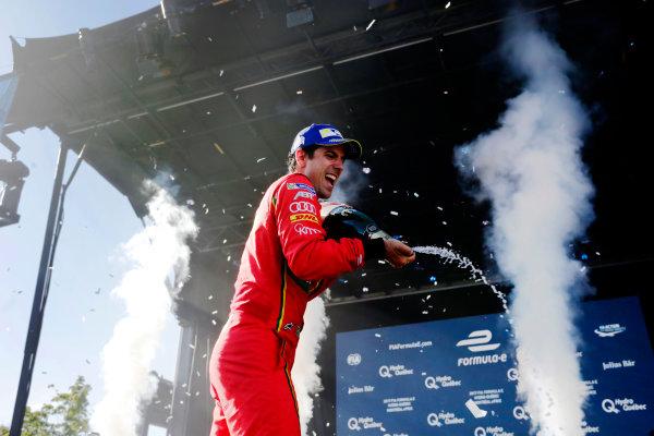 2016/2017 FIA Formula E Championship. Round 11 - Montreal ePrix, Canada Saturday 29 July 2017. Winner Lucas Di Grassi (BRA), ABT Schaeffler Audi Sport, Spark-Abt Sportsline, ABT Schaeffler FE02, sprays the champagne on the podium. Photo: Andrew Ferraro/LAT/Formula E ref: Digital Image _FER4528