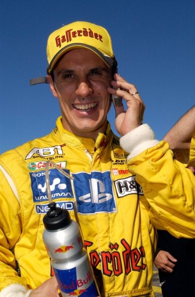 Laurent Aiello (FRA) Team Abt Sportsline, is being congratulated by mobile phone with another pole position.