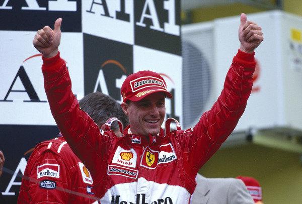 1999 Austrian Grand Prix.A1 Ring, Zeltweg, Austria.23-25 July 1999.Eddie Irvine (Ferrari) celebrates 1st position on the podium.Ref-99 AUT 04.World Copyright - LAT Photographic