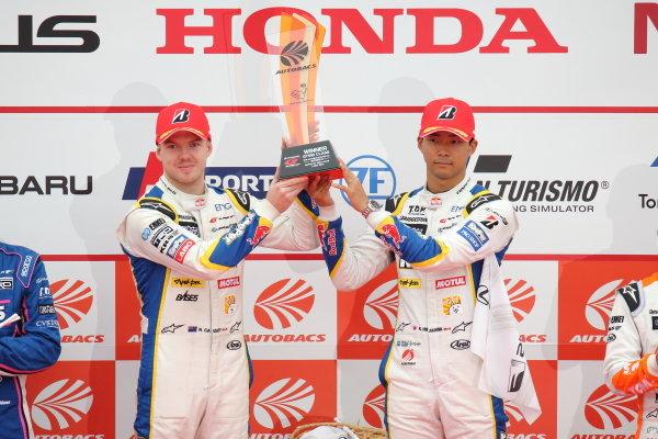 GT500 Winners Ryo Hirakawa & Nick Cassidy, Lexus Team KeePer TOM'S LC500, celebrate on the podium