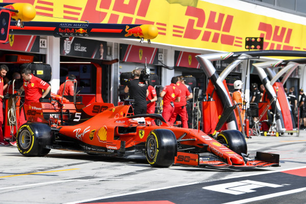 Sebastian Vettel, Ferrari SF90, leaves the garage