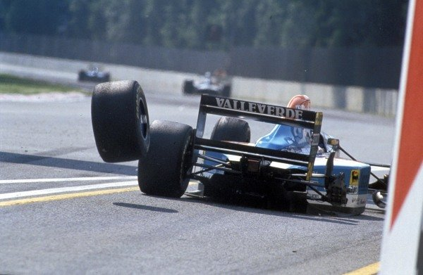 The right-rear wheel of Michele Alboreto, Minardi M193B Ford, bounces down the pitlane after falling off.