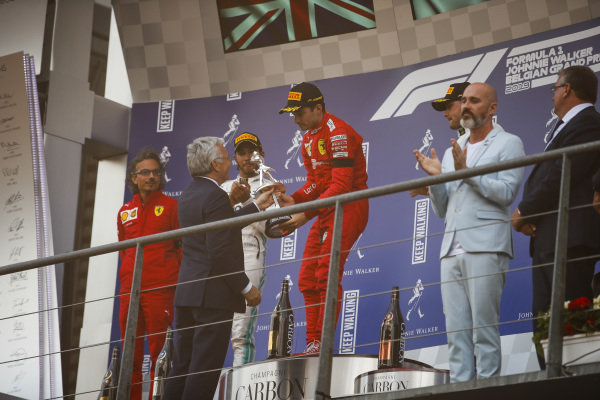Charles Leclerc, Ferrari, 1st position, receives the winners trophy