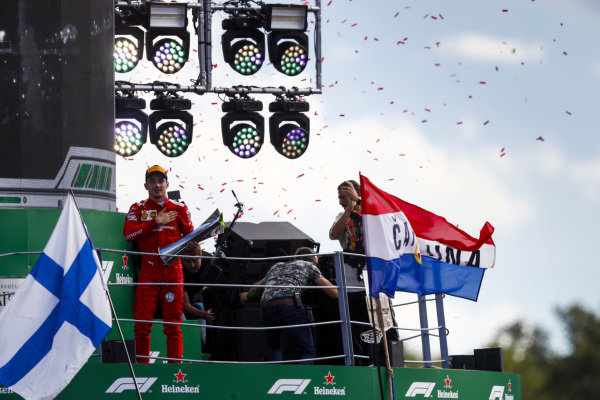 Race winner Charles Leclerc, Ferrari celebrates on the podium with the trophy