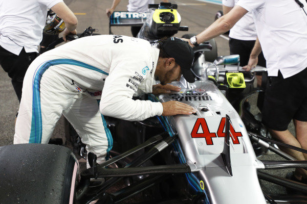 Lewis Hamilton kisses his Mercedes AMG F1 W09 EQ Power+ after taking Pole Position