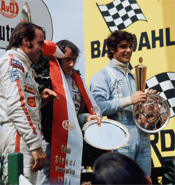 2003 Racing Past. . Exhibition1971 German Grand Prix, Nurburgring. Jackie Stewart, Francois Cevert and Clay Regazzoni on the podium.World Copyright - LAT PhotographicExhibition ref: a054