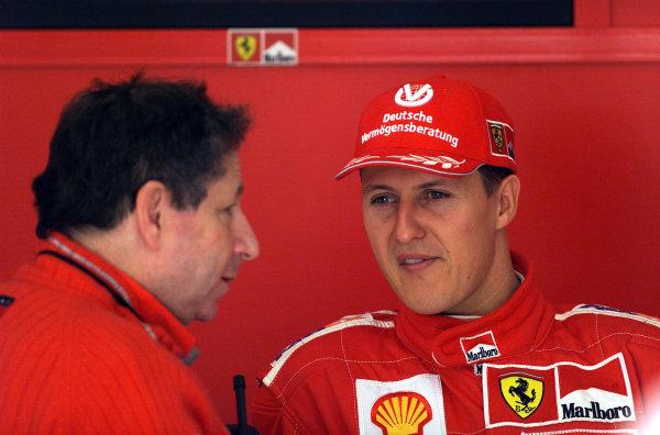 2001 Spanish Grand PrixCatalunya, Barcelona, Spain. 27-29 April 2001. Michael Schumacher (Ferrari) talks with Ferrari Team Principal Jean Todt.World Copyright - Steve Etherington/LAT Photographicref: 18 mb Digital Image