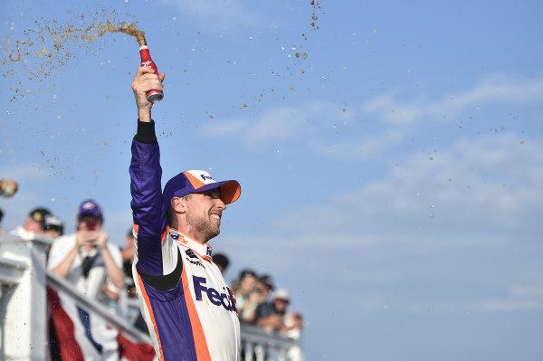 #11: Denny Hamlin, Joe Gibbs Racing, Toyota Camry FedEx Ground, celebrates after winning in Pocono.