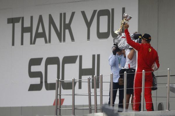 Sebastian Vettel, Ferrari, 3rd position, lifts his trophy