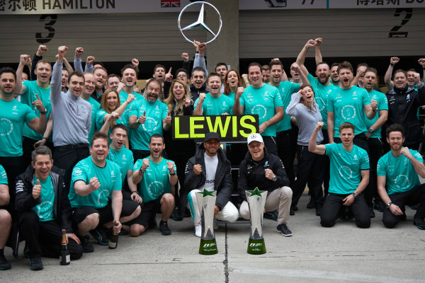 Shanghai International Circuit, Shanghai, China.  Sunday 9 April 2017. Lewis Hamilton, Mercedes AMG, 1st Position, and Valtteri Bottas, Mercedes AMG, celebrate with the Mercedes AMG team. World Copyright: Steve Etherington/LAT Images ref: Digital Image SNE28604