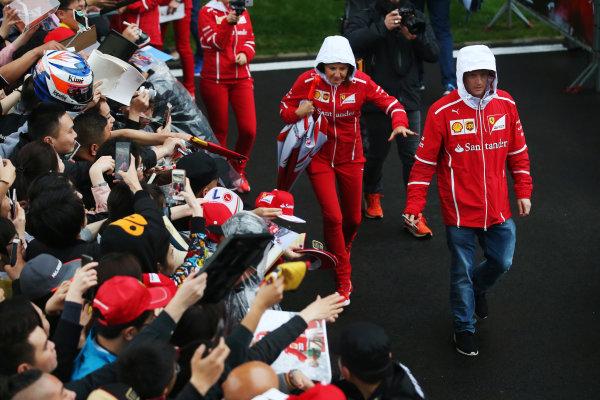 Shanghai International Circuit, Shanghai, China.  Thursday 06 April 2017.  Kimi Raikkonen, Ferrari SF70H, attends an autograph session. World Copyright: Charles Coates/LAT Images  ref: Digital Image GJ9R7280