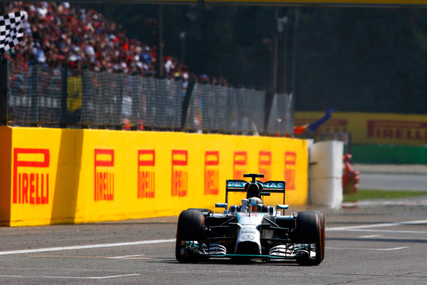 Autodromo Nazionale di Monza, Monza, Italy. Sunday 7 September 2014. Lewis Hamilton, Mercedes F1 W05 Hybrid, takes the chequered flag for victory. World Copyright: Charles Coates/LAT Photographic. ref: Digital Image _N7T1065