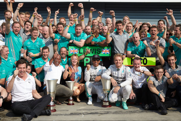 Autodromo Nazionale di Monza, Monza, Italy. Sunday 7 September 2014. Lewis Hamilton, Mercedes AMG, 1st Position, Nico Rosberg, Mercedes AMG, 2nd Position, Toto Wolff, Executive Director (Business), Mercedes AMG, Paddy Lowe, Executive Director (Technical), Mercedes AMG, and the Mercedes AMG team celebrate.  World Copyright: Steve Etherington/LAT Photographic. ref: Digital Image SNE15861