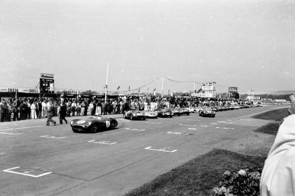 Goodwood, West Sussex, Great Britain. 5th September 1959. Stirling Moss and Carroll Shelby, both Aston Martin, are first away at the start. Dan Gurney, #9 Ferrari, was left until half the field had started, action. World Copyright: LAT PhotographicRef: Autosport b&w print. Published: Autosport 11/9/1959 p336