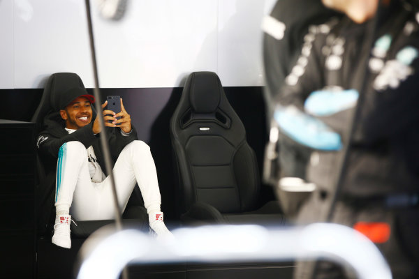 Shanghai International Circuit, Shanghai, China.  Friday 07 April 2017. Lewis Hamilton, Mercedes AMG, uses a phone in his team's garage during a weather delay in FP2. World Copyright: Andy Hone/LAT Images ref: Digital Image _ONY4088