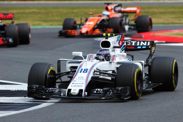 Silverstone, Northamptonshire, UK.  Sunday 16 July 2017. Lance Stroll, Williams FW40 Mercedes, leads Fernando Alonso, McLaren MCL32 Honda. World Copyright: Charles Coates/LAT Images  ref: Digital Image AN7T1718