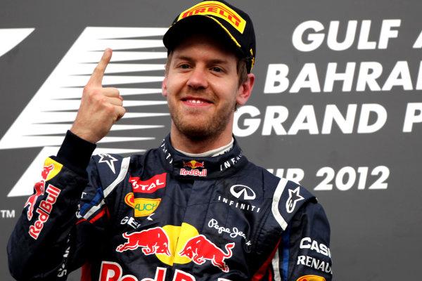 Bahrain International Circuit, Sakhir, Bahrain22nd April 2012Sebastian Vettel, Red Bull Racing, 1st position, celebrates on the podium.World Copyright: Andy Hone/LAT Photographicref: Digital Image HONY8651