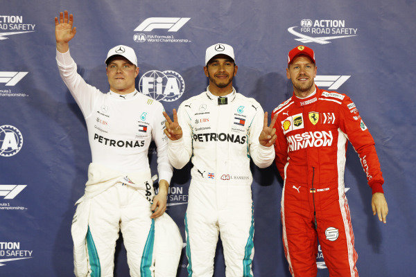 Lewis Hamilton, Mercedes AMG F1, celebrates after taking pole position with Valtteri Bottas, Mercedes AMG F1, and Sebastian Vettel, Ferrari