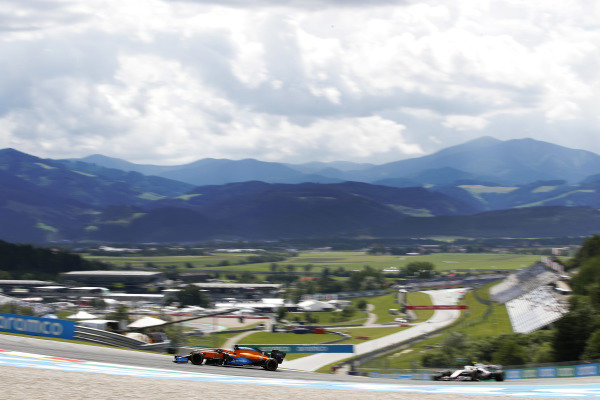 Daniel Ricciardo, McLaren MCL35M, leads Mick Schumacher, Haas VF-21