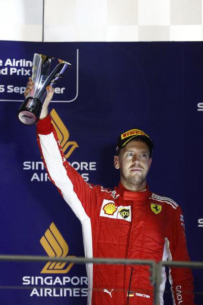 Sebastian Vettel, Ferrari, 3rd position, with his trophy on the podium