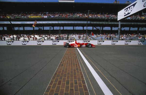 Rubens Barrichello, Ferrari F2002, crosses the yard of bricks.