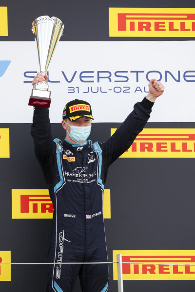 Race Winner Dan Ticktum (GBR, DAMS) celebrates on the podium with the trophy