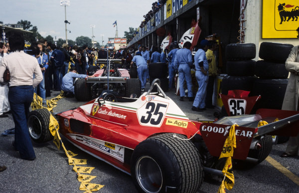 Carlos Reutemann's Ferrari 312T2 sat at the end of the pitlane, draped in Agip bunting.