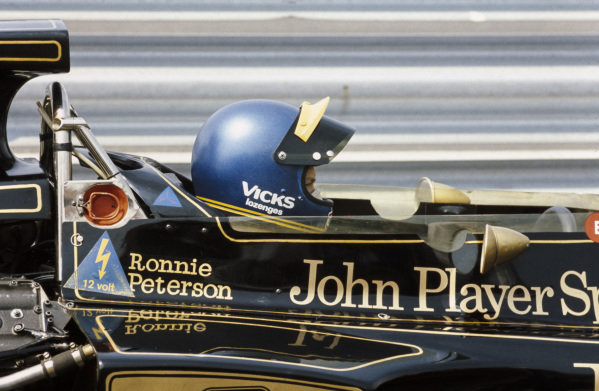 Ronnie Peterson sat in his Lotus 72E Ford in the pitlane.