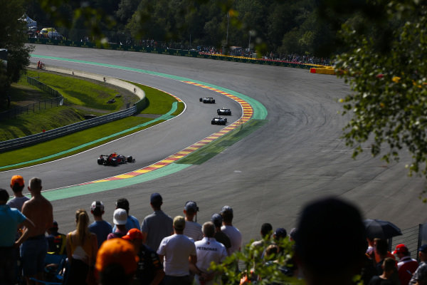 Kevin Magnussen, Haas VF-19, leads Valtteri Bottas, Mercedes AMG W10, Lewis Hamilton, Mercedes AMG F1 W10, and Max Verstappen, Red Bull Racing RB15