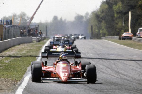 Michele Alboreto, Ferrari 126C4, leads Derek Warwick, Renault RE50, René Arnoux, Ferrari 126C4, and Manfred Winkelhock, ATS D7 BMW.