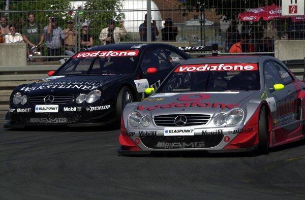 2002 DTM Championship Norisring, Germany. 29th - 30th June 2002. Bernd Schneider battles with Uwe Alzen (HWA Mercedes), action.World Copyright: Andre Irlmeier/LAT Photographic