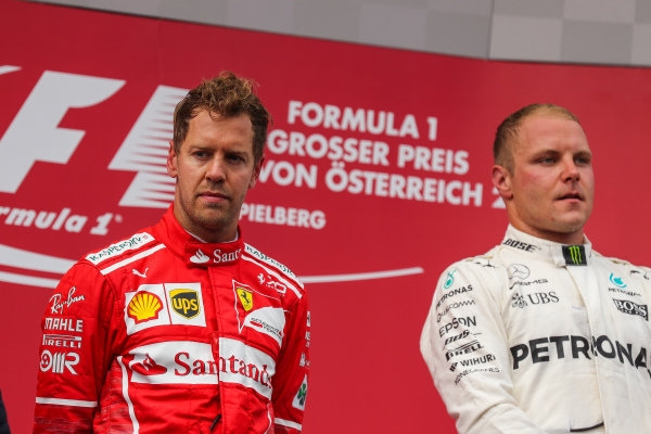Sebastian Vettel (GER) Ferrari and Valtteri Bottas (FIN) Mercedes AMG F1 celebrate on the podium at Formula One World Championship, Rd9, Austrian Grand Prix, Race, Spielberg, Austria, Sunday 9 July 2017.