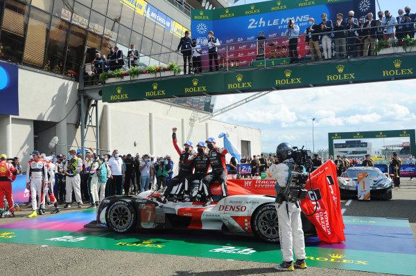Winners Mike Conway, Kamui Kobayashi, Jose Maria Lopez, #7 Toyota Gazoo Racing Toyota GR010 - Hybrid Hypercar celebrate