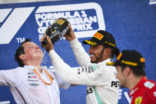 Lewis Hamilton, Mercedes AMG F1, 1st position, pours Champagne over Fred Judd, Chief Engineer Trackside, Mercedes AMG F1, on the podium