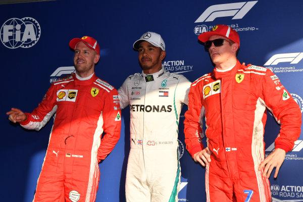 (L to R): Sebastian Vettel (GER) Ferrari, pole sitter Lewis Hamilton (GBR) Mercedes-AMG F1 and Kimi Raikkonen (FIN) Ferrari celebrate in parc ferme