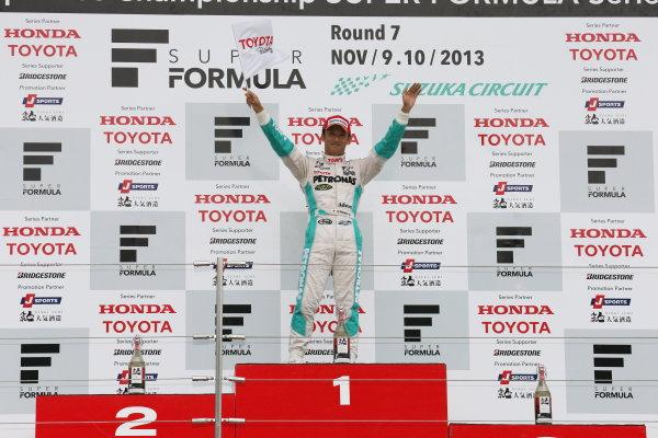Suzuka, Japan. 9th - 10th November 2013. Rd 7. Race 2. Winner Kazuki Nakajima ( #1 PETRONAS TEAM TOM'S ) podium, portrait. World Copyright: Yasushi Ishihara/LAT Photographic. Ref: 2013SF_Rd7_025