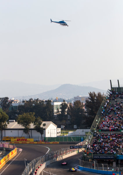 2015/2016 FIA Formula E Championship. Mexico City ePrix, Autodromo Hermanos Rodriguez, Mexico City, Mexico. Saturday 12 March 2016. Jerome D'Ambrosio (FRA) Dragon Racing - Venturi VM200-FE-01, Sebastien Buemi (SUI), Renault e.Dams Z.E.15. Photo: Zak Mauger/LAT/Formula E ref: Digital Image _79P3719