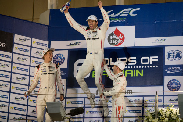2015 WEC Bahrain International Circuit, Bahrain Saturday 21 November 2015. Mark Webber, Timo Bernhard and Brendon Hartley (#17 Porsche 919 Hybrid) celebrate on the podium after winning the drivers' championship. Photo: Sam Bloxham/LAT ref: Digital Image _SBL5899