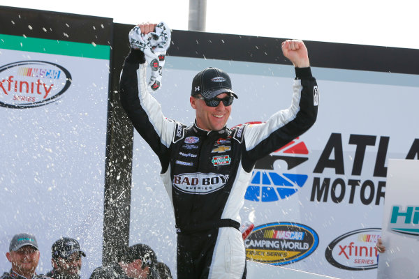 27-28 February 2015, Hampton, Georgia USA Kevin Harvick celebrates in victory lane ?2015, Russell LaBounty LAT Photo USA