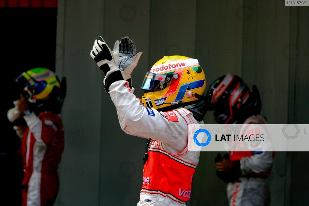 2007 Spanish Grand Prix Circuit de Catalunya, Barcelona, Spain. 11th - 13th May 2007. Lewis Hamilton, McLaren MP4-22 Mercedes, celebrates on arrival in Parc Ferme. Portrait. Helmets. Finish. World Copyright: Lorenzo Bellanca/LAT Photographic ref: Digital Image ZD2J8493