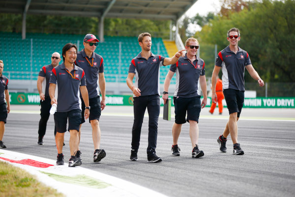 Autodromo Nazionale di Monza, Italy. Thursday 31 August 2017. Kevin Magnussen, Haas VF-17 Ferrari, walks the track with his team. World Copyright: Andy Hone/LAT Images  ref: Digital Image _ONZ0201
