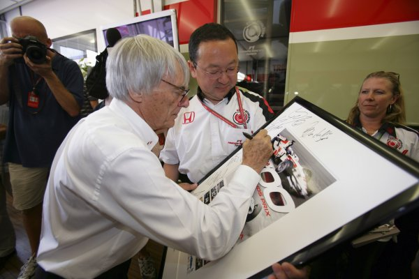 2006 German Grand Prix - Friday Practice Hockenheim, Germany. 27th - 30th July. Bernie Ecclestone and Yasuhiro Wada, portrait. World Copyright: Lorenzo Bellanca/LAT Photographic ref: Digital Image AZD2J0329