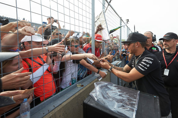 Circuit Gilles Villeneuve, Montreal, Canada. Sunday 7 June 2015. Lewis Hamilton, Mercedes AMG, signs autographs for fans. World Copyright: Steve Etherington/LAT Photographic. ref: Digital Image SNE21152