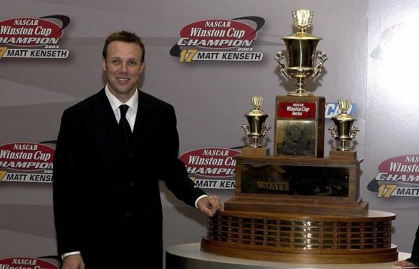 2003 Champion Matt Kenseth (USA) with the Winston Cup trophy.