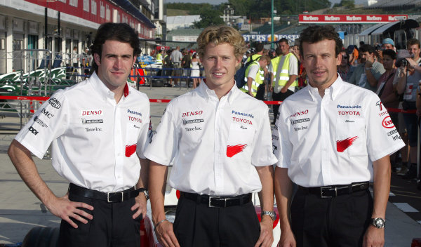 2004 Hungarian Grand Prix - Thursday,2004 Hungarian Grand Prix Budapest, Hungary. 12th August 2004 This weekend's Toyota drivers - Ricardo Zonta, Ryan Briscoe, and Olivier Panis. Portrait.World Copyright: Steve Etherington/LAT Photographic ref: Digital Image Only